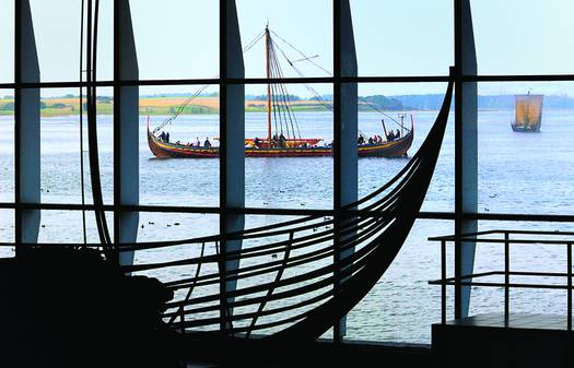 The original Viking ships presents itself beautifully at Roskilde Fjord and the impressive reconstructions as a backdrop.