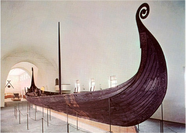 The well preserved Oseberg ship from 820 in the Viking Ship Hall in Oslo, Norway. Photo Museum of Cultural History